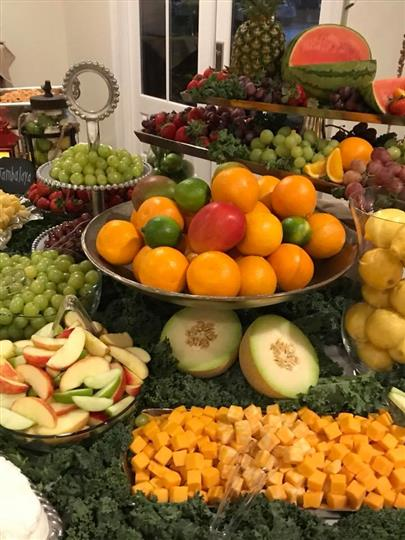 Assortment of a plethora of fruits on a table with a arranged display