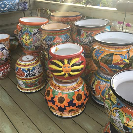Flower pots with decorative paints on each one