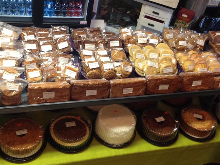 Baked assortment of cakes, pies, and cookies on a display
