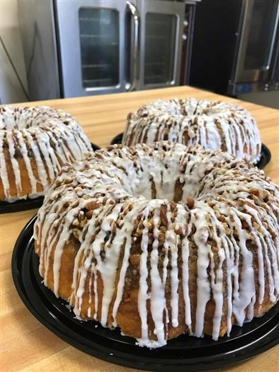 Bundt cake with icing and crumbles