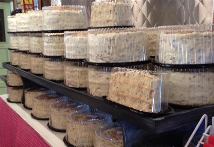 Multiple assorted cakes on a display stacked on each other