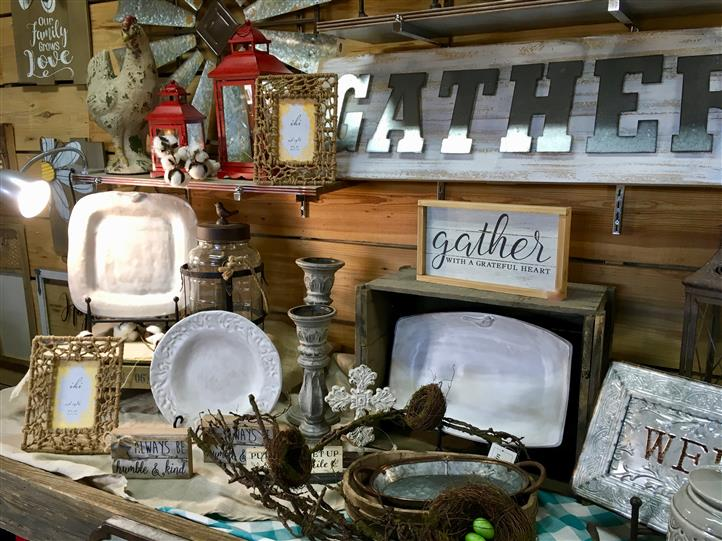 Plates, Picture frames, and candle holders on a display for sale