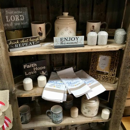 Gift shop display with towels and mugs