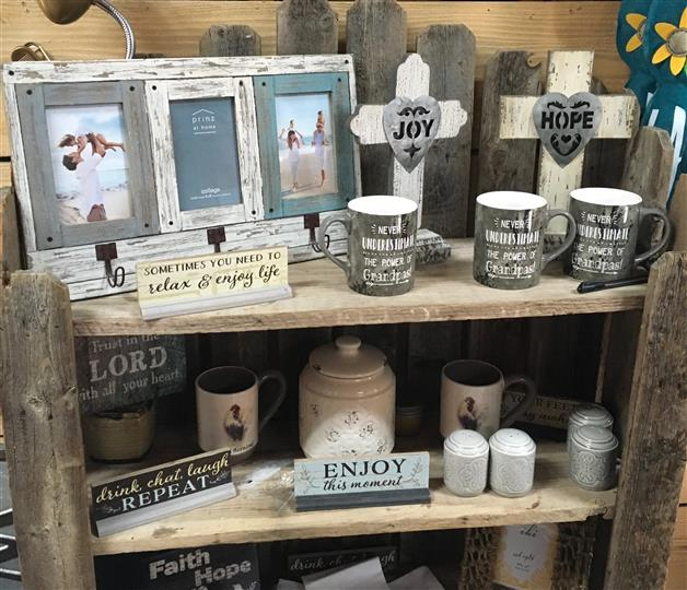Gift shop with mugs, signs, and picture frames