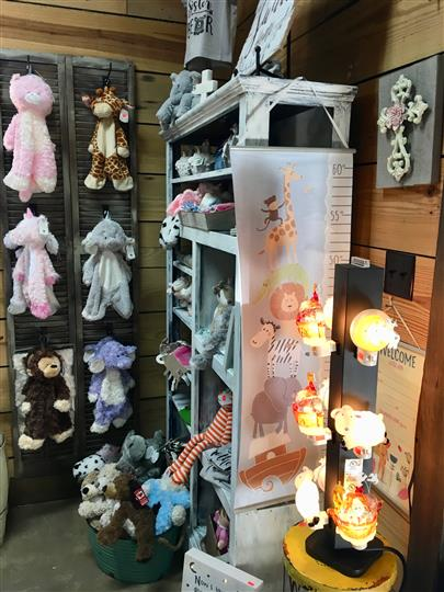 Gift shop with multiple animal plush toys and night lights