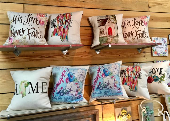 Multiple throw pillows on sale with designs on them