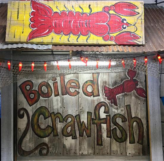 Boiled craw fish sign with painting of crawfish