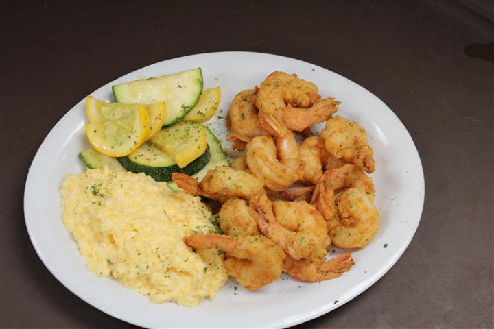 fried shrimp and grits with vegetables