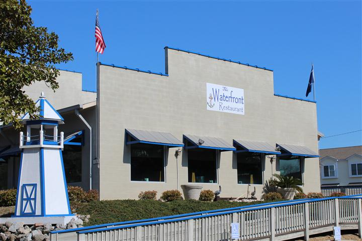 exterior side of the waterfront restaurant showcasing the windows