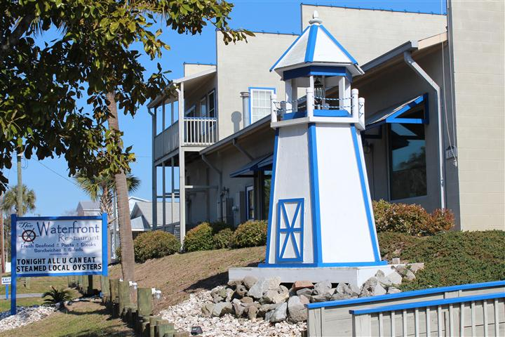 exterior landscape displaying a miniature lighthouse decoration