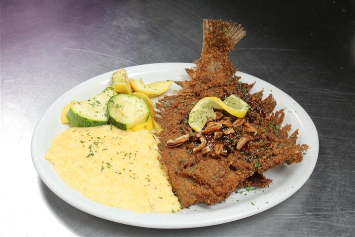 fried fish with grits and vegetables