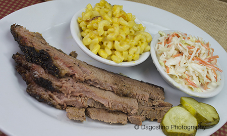 Smoked meat with a side of mac and cheese and coleslaw