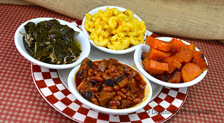 Four side bowls with mac & cheese, candied yams, baked beans and collard greens