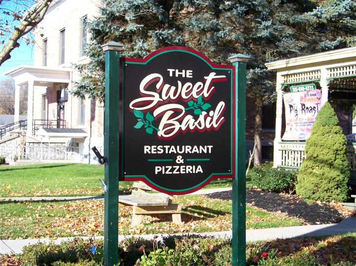 Exterior signage of The Sweet Basil Restaurant & Pizzeria