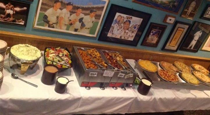 buffet of food on table with pictures on wall