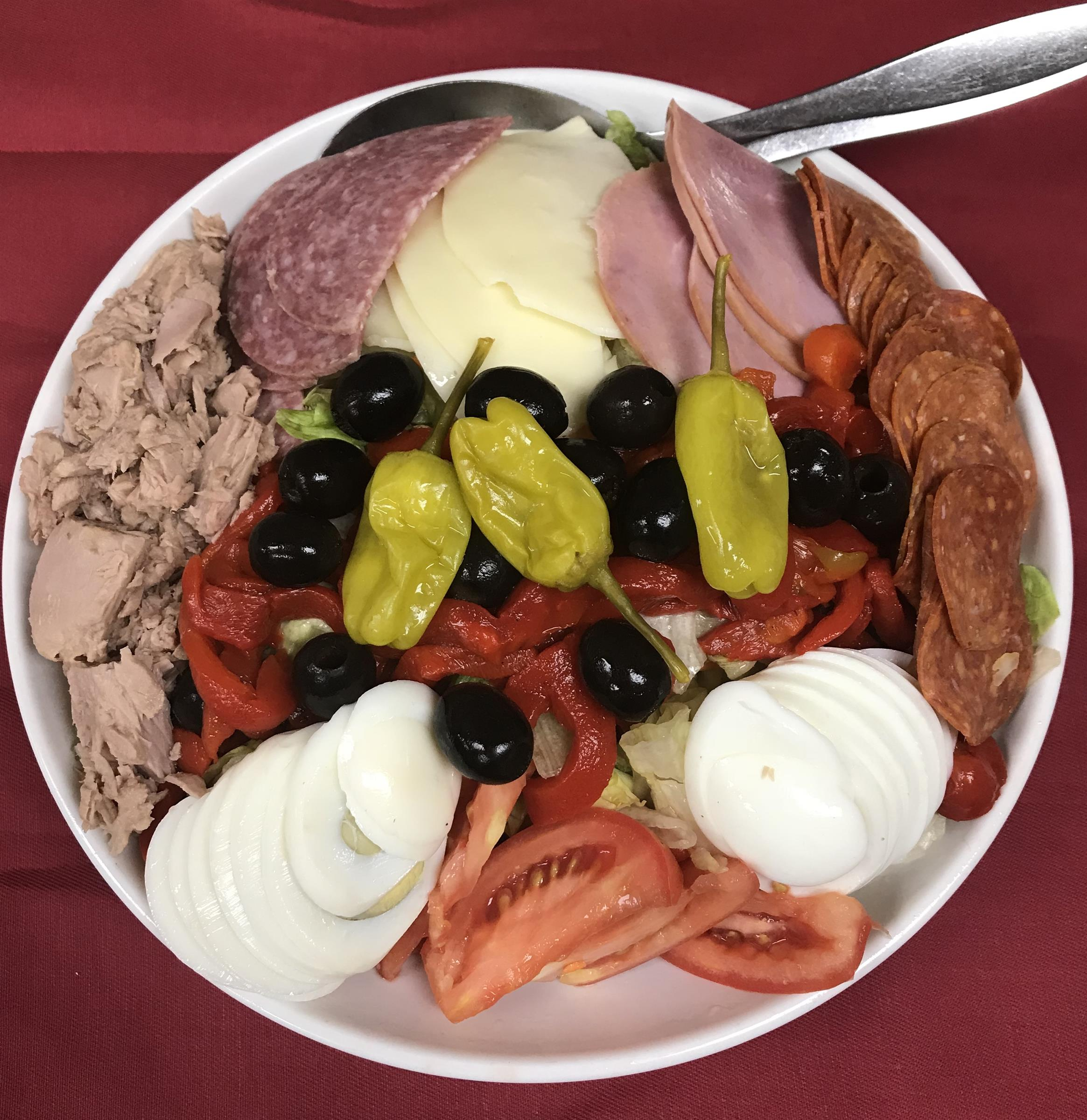 antipasto salad with, Salami, Capacola, Provolone Cheese, tomatoes, black olives, and pepperoncini's.