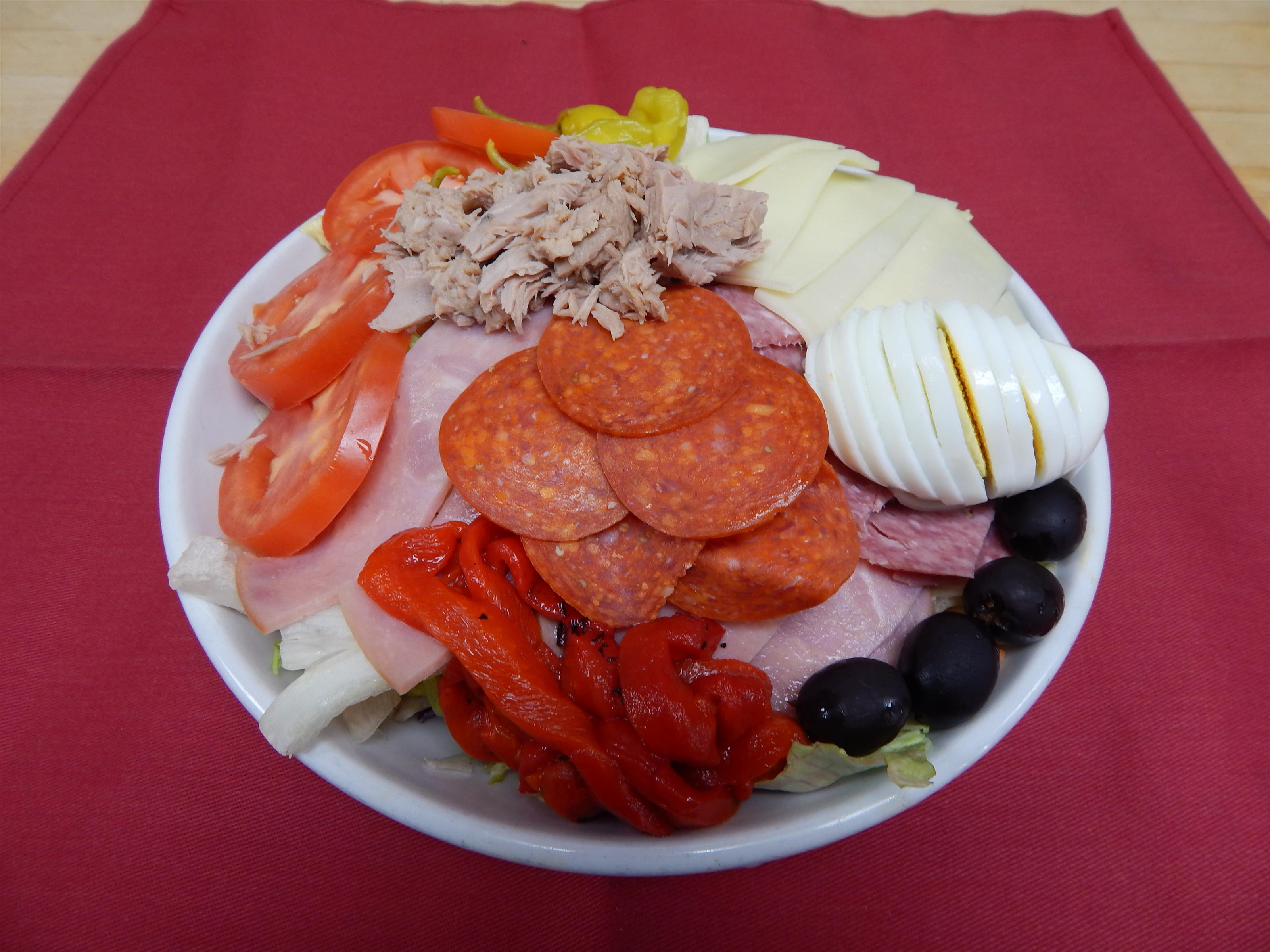 antipasto supreme with, Salami, Capacola, Provolone Cheese, tomatoes, black olives, pepperoncini's, hard boiled eggs, tuna fish and pepperoni.