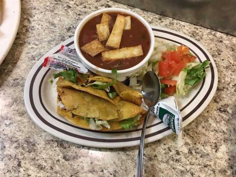 soup, salad, and a sandwich on a plate