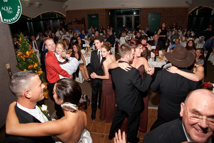 crowded dining area filled with people dancing together dressed up