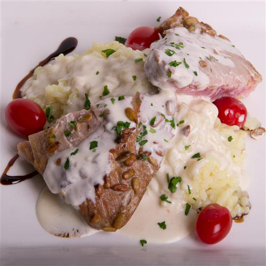 cooked meat over risotto with tomatoes