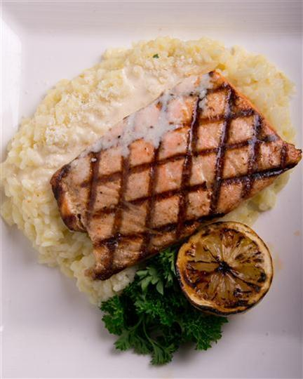 grilled salmon over a bed of rice