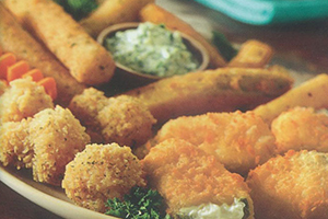 Plate of appetizers.  Mozzarella sticks, jalapeno poppers