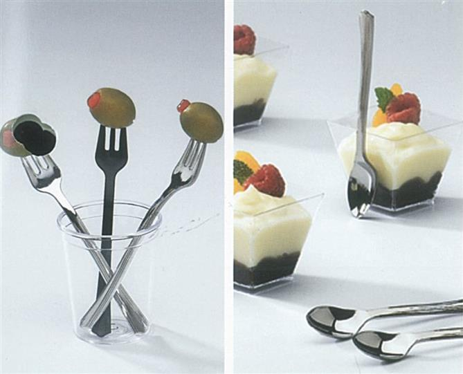 Small tasting spoons and forks with olives and desserts