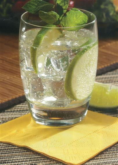 Sun colored napkin under lime drink