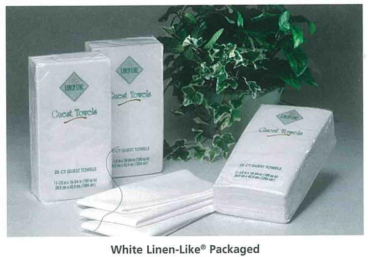 White linen-like packaged guest towels on table