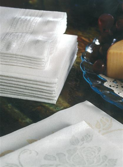 White guest towels on wood table