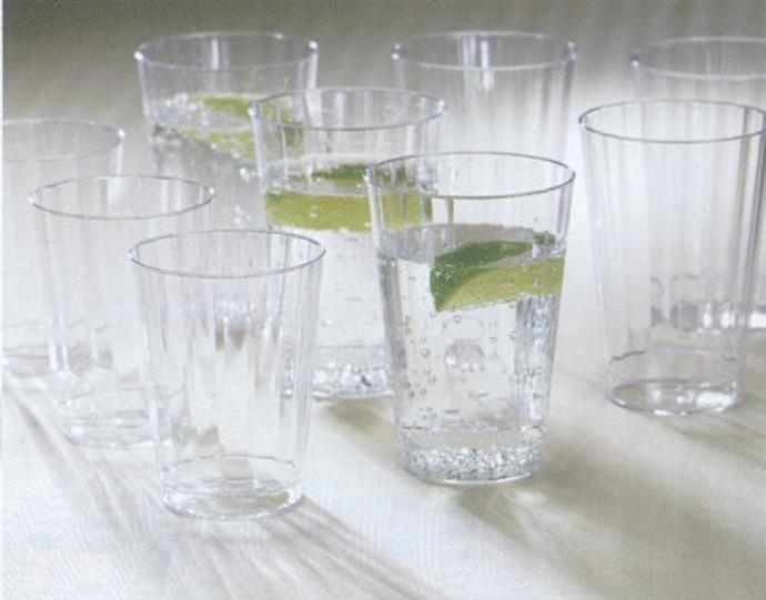 Clear tumblers with lime drinks on table