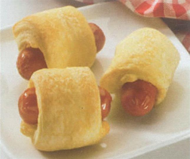 Beef franks in pastry on square white plate