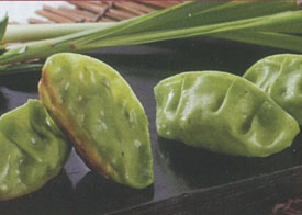 Vegetable Thai potstickers on black tray