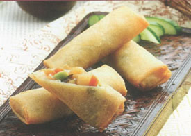 Crispy shrimp spring roll and cucumber on brown tray