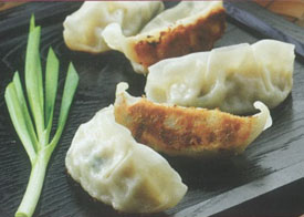 Gourmet Potstickers on black tray
