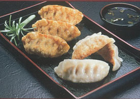 Potstickers on black tray
