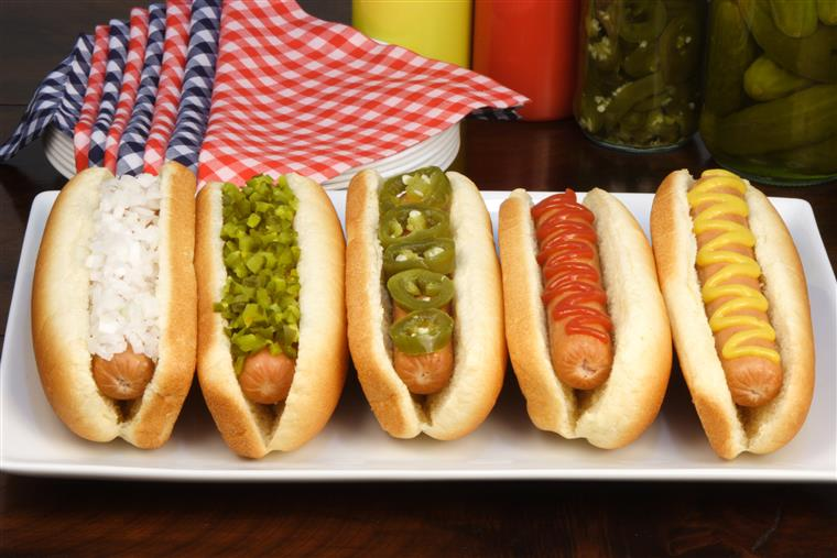 Beef hot dogs with mustard, ketchup, relish, jalapenos, and onions