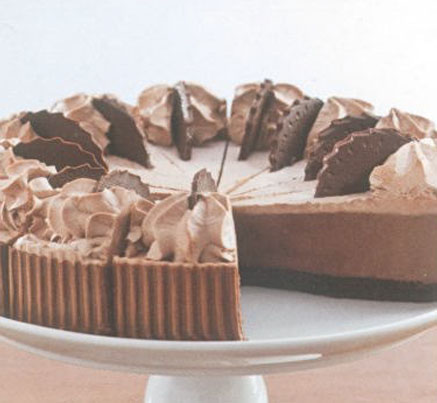 Belgian Chocolate Mousse Cake sliced on white serving dish