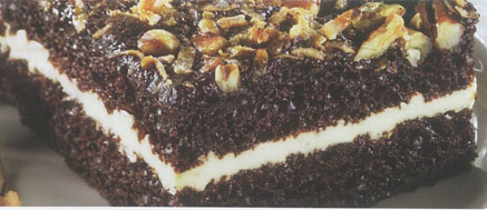 German chocolate cake topped with coconut and pecans