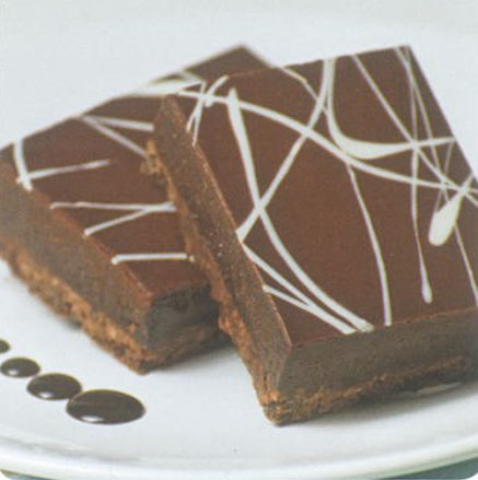 Silky truffle covering a chocolate shortbread crust, finished with white chocolate and dark chocolate ganache.