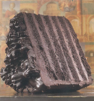 Big chocolate cake slice with multiple layers