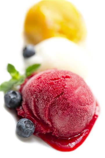 Assorted italian ice flavors with blueberry garnish