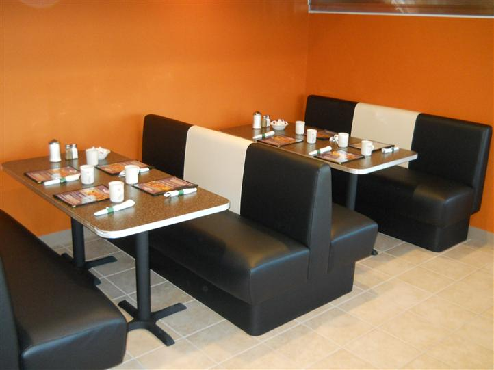 interior dining area setup with booths, and chairs