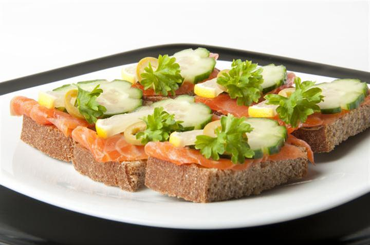 ---- small salmon sandwich on plate over white (large)