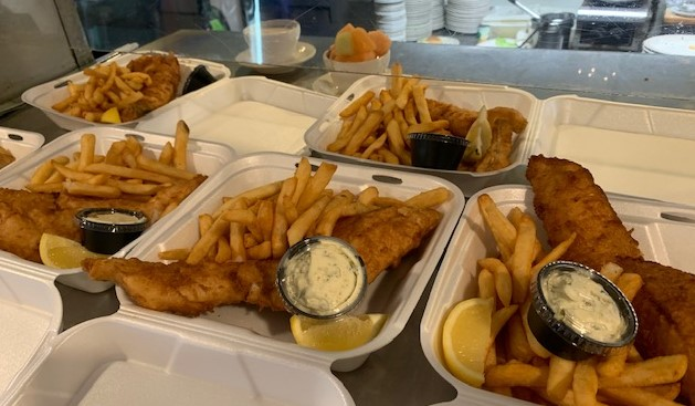 several containers of fish with french fries