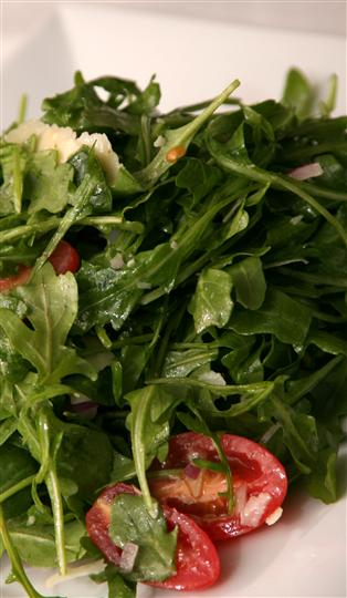 Arugula and sliced cherry tomatoes