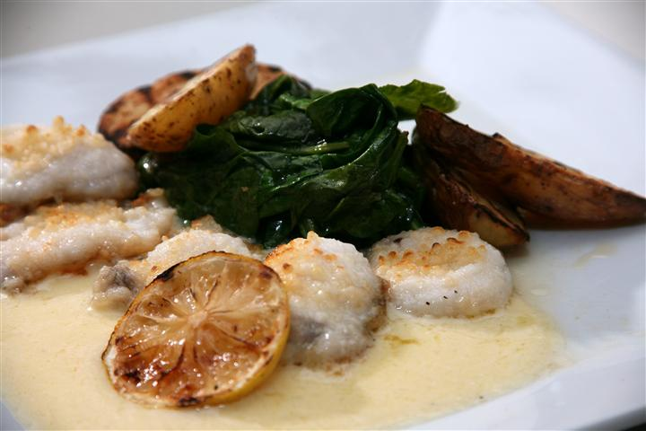 Seafood with spinach and potatoes
