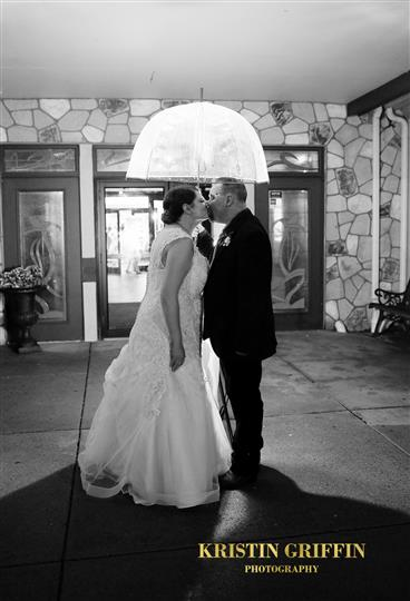 Bride and Groom kissing near the church entrance