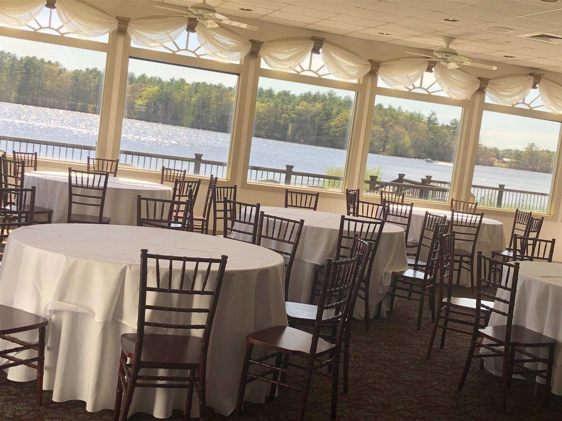 sunset room next to the lake setup with tables and chairs