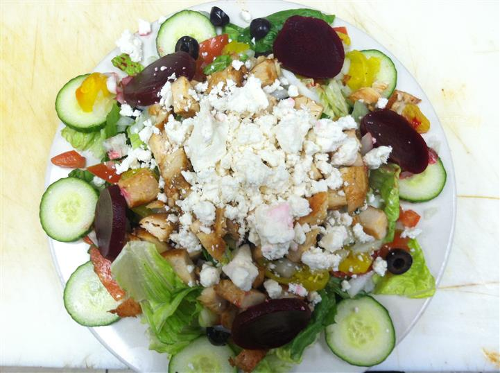 Fresh vegetables salad with croutons and shredded feta cheese
